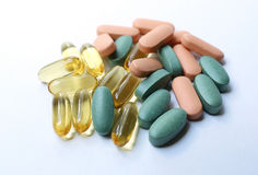 Colourful pills on a white background stock photography