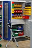 Bins and trays. Colourful plastic bins and trays in storage room royalty free stock photos