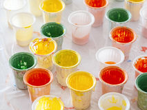 Colourful Plastic Cup on Table Colours Painting pallette Royalty Free Stock Photography