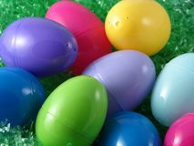 Colourful Plastic Easter Eggs. On fake grass Royalty Free Stock Image