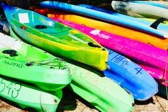 Colourful Plastic Rental Kayaks on Dry Land