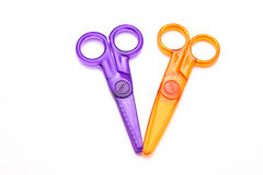 Colourful Plastic Scissors. Childres' plastic scissors, isolated on white Royalty Free Stock Photos
