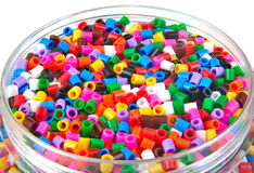 Colourful plastic small cylinders toys Stock Photo