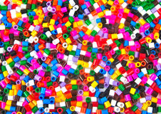 Colourful plastic small cylinders toys Royalty Free Stock Image