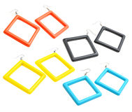 Colourful plastic square earrings isolated on white backg Stock Photo