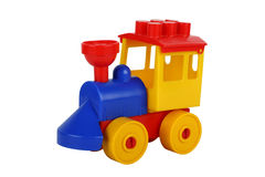 Colourful plastic toy train. It is isolated on the white Royalty Free Stock Images