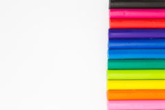 Colourful plasticine clay on right side of white background Royalty Free Stock Images