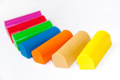 Colourful plasticine on a white background Stock Images