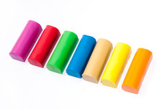 Colourful plasticine on a white background Royalty Free Stock Image