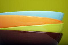 Colourful plates. A pile of four nice coloured plates royalty free stock photography