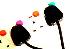 Colourful plugs and sockets. A colourful electrical adaptor for multiple plugs and sockets Stock Images