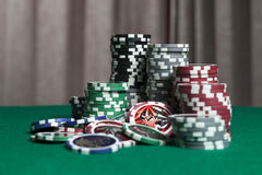 Colourful poker chips on green background. With copy space Royalty Free Stock Photography
