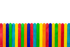 Colourful popsicle sticks. Colourful wooden popsicle sticks on white background stock photography