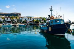 Colourful port with palm trees in Puerto De Mogan Stock Image