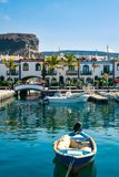 Colourful port with palm trees in Puerto De Mogan Stock Photo
