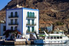Colourful port with palm trees in Puerto De Mogan Stock Photos