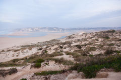 Colourful Portugese coast. Seascape of the Portuguese coastline on cloudy day Royalty Free Stock Photography