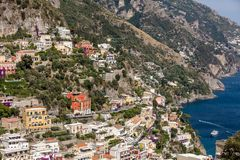 Colourful Positano, the jewel of the Amalfi Coast,. With its multicoloured homes and buildings perched on a large hill overlooking the sea. Italy Stock Photo