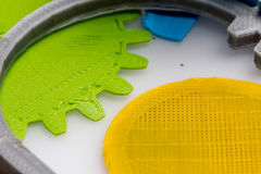 Colourful printed parts using 3d printer. These are the  prototyping materials that going to be used in project Royalty Free Stock Photo