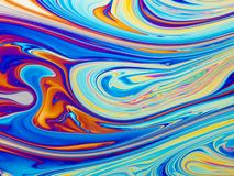Colourful psychedelic soap bubble refractions pattern macro. stock photos