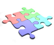 Colourful Puzzles. Four colourfull puzzle pieces. Isolated on white Stock Images
