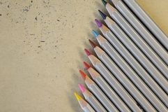 Colourful rainbow pencils for drawing on the paper background. Colourful pencils for drawing and school art on the paper background. Office colored equipment Stock Photography