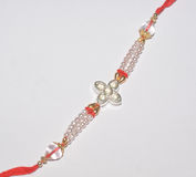 A colourful Rakhi with white stones. Stock Photography