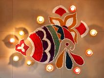 Colourful rangoli with deepak stock image