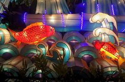 Colourful red fish lantern. Lifely and bright fish cartoon lantern . Lifely and bright cartoon lantern . Bright lanterns light up the city in the evening and stock photo