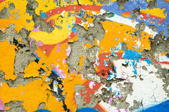Colourful remnants of peeling graffiti Stock Images