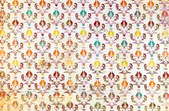 A colourful repeat pattern  damask wallpaper. A closeup of a lovely colorful  monochrome  antique   shabby  chic damask pattern printed on a paper background Royalty Free Stock Images