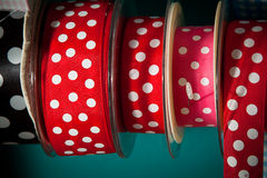 Colourful ribbon. Reels in a haberdashyery. White ploka dots on red and pink Royalty Free Stock Photo