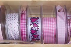 Colourful ribbons and tape. Brightly coloured fashion ribbon and tape for sewing, needlework or dressmaking on reels at a market stall . The colour mixes were Stock Images