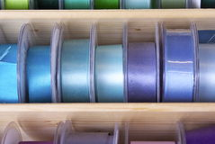 Colourful ribbons and tape. Brightly coloured fashion ribbon and tape for sewing, needlework or dressmaking on reels at a market stall . The colour mixes were Royalty Free Stock Photo