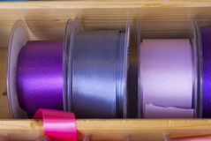 Colourful ribbons and tape. Brightly coloured fashion ribbon and tape for sewing, needlework or dressmaking on reels at a market stall . The colour mixes were Royalty Free Stock Image