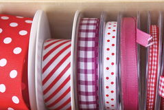Colourful ribbons and tape. Brightly coloured fashion ribbon and tape for sewing, needlework or dressmaking on reels at a market stall . The colour mixes were Royalty Free Stock Photos