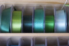 Colourful ribbons and tape. Brightly coloured fashion ribbon and tape for sewing, needlework or dressmaking on reels at a market stall . The colour mixes were Royalty Free Stock Images