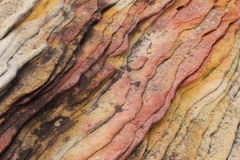 Colourful ridged sandstone. Close up of colorful ridged sandstone texture Stock Images