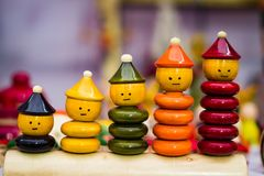 Colourful ring toy stacking doll figures with increasing sizes.  Royalty Free Stock Photography