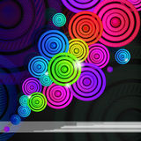 Colourful rings on a black background. royalty free stock photography