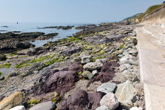 Colourful rocks Portwrinkle Whitsand Bay Cornwall England Royalty Free Stock Photos