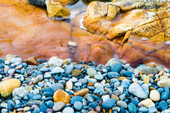 Colourful rocks and water. At Diamond Head coast, Australia Royalty Free Stock Image
