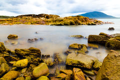 Colourful rocks and water Stock Image