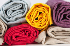 Colourful rolled cotton towels Stock Photos