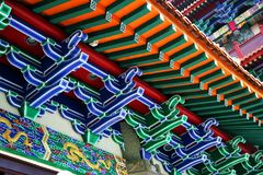 The colourful roof of a Buddhist temple. With gold dragons and white highlights stock photography