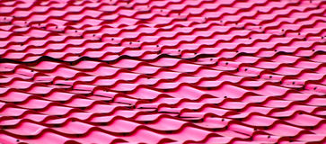 Metallic red roof top background. Beautiful pink coloured roof top background photograph captured from a tourist spot around Bangladesh royalty free stock photo