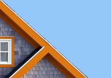 Colourful rooftops and blue sky. Detail of the rooftops of the typical wooden houses of Iles de la Madeleine, or the Magdalen Islands, in Canada. Minimalistic royalty free stock photo