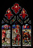 Colourful  rose  stained glass window panel in Edinburgh Stock Image