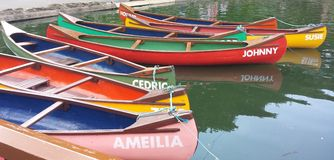 Colourful rowing boats. Personalised with names Stock Images