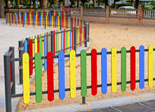 Colourful rows of painted wood on a playground fen Royalty Free Stock Photo